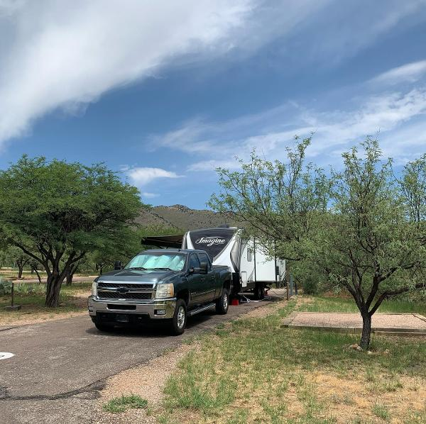 An RV parked in a camping space at Kartchner Caverns State Park