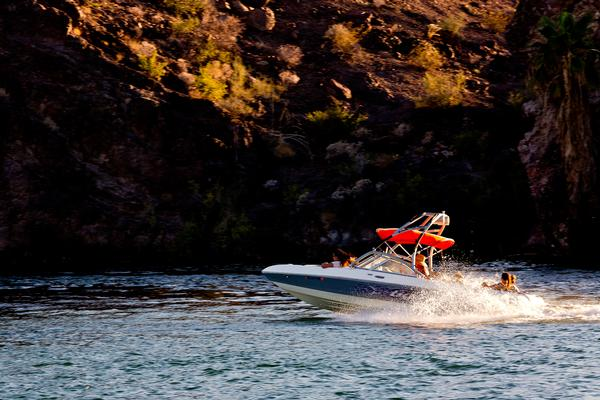 A boat motors down the Colorado River at Buckskin Mountain State Park.