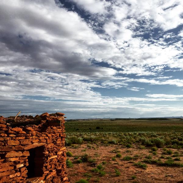 A view of the sweeping sky above a Hopi pueblo ruin at Homolovi State Park.