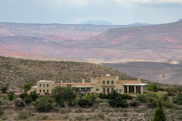 The Douglas Mansion is a great historic site in Jerome, AZ with a view of the town on the hill and mining equipment.