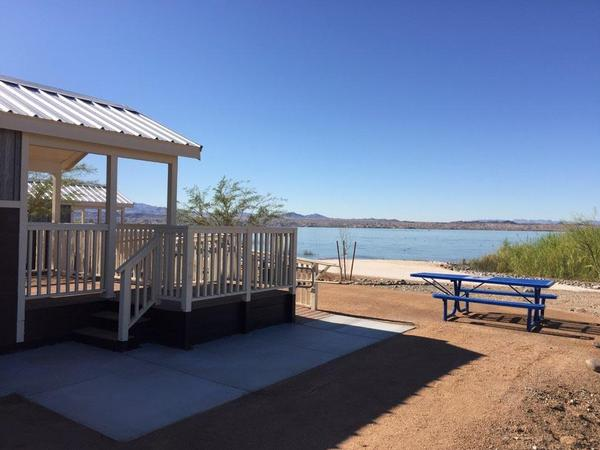 The cabins on the white sand beach with the Colorado River lapping at the shore.