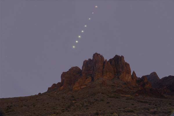 A composite of the moon phases over the Superstition Mountains at Lost Dutchman State Park.