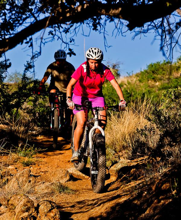 Two mountain bikers on a trail at Oracle State Park