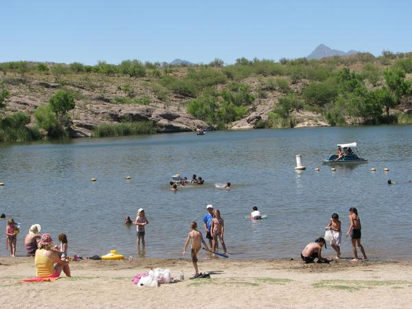 Kids and adults play in the water at Patagonia Lake State Park.