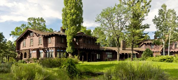 The expansive Riordan Mansion State Historic Park, surrounded by lush Flagstaff greenery.