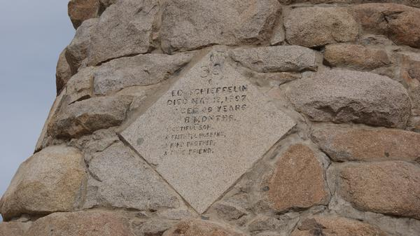 A close-up view of the inscription on the monument for Ed Schieffelin.