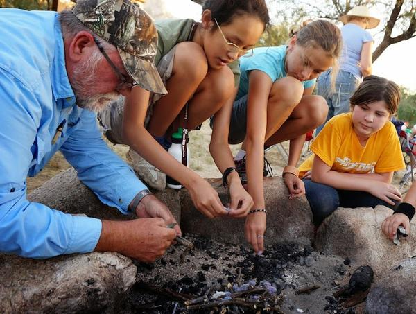 Learning to build a campfire during a weekend campout