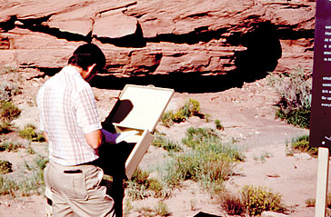 A visitor enjoys an interpretive sign and brochure in 1984