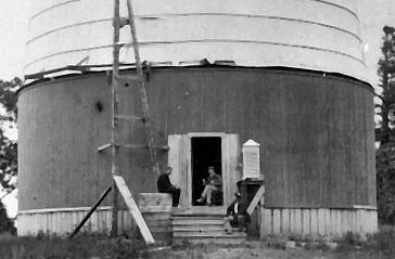 A.E. Douglass sitting in the doorway of the dome for the 24-inch Alvan Clark refracting telescope at Lowell Observatory in Flagstaff, Arizona, circa 1897. Photo courtesy of Lowell Observatory Archives.